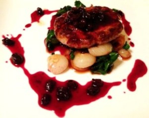 Venison Salisbury Steak, With Raisin Sauce And Ramp Leaves.