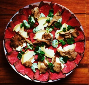 Beef Carpaccio With Watercress, Goat Cheese And Pickled Maitake