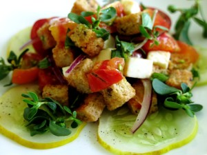 recipe for purslane panzanella with golden cucumbers and heirloom tomatoes