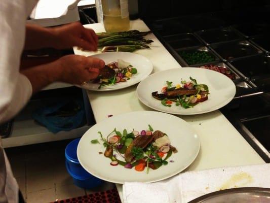 chef brett weber plating an amazing dish