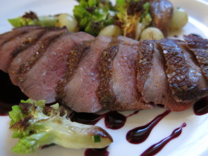 Seared Teal, Wild Grape Sauce, Romanesco, and Pearl Onions