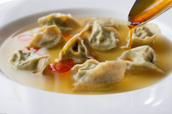 stinging nettle tortelli in lactarius broth