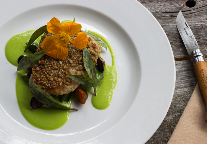 Sunflower seed crusted whitefish with two lillies, peas and carrots