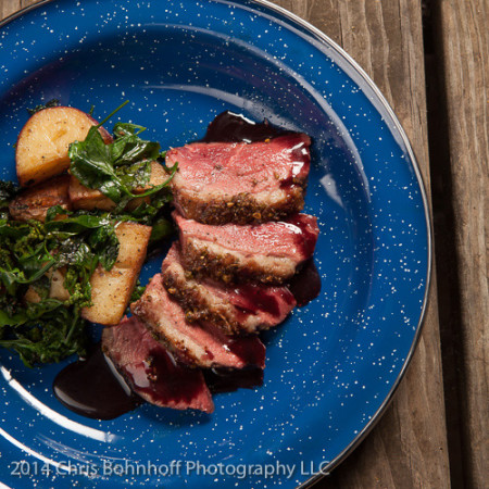 duck breast with wild juniper, black cap berry sauce, duck fat potatoes and wild spinach