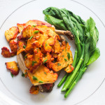 Chicken smothered with chicken of the woods, with milkweed shoots