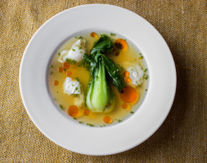 Bok choi in Lactarius mushroom broth with quail eggs.