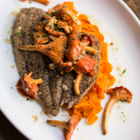 Buckwheat crusted sole with red chanterelle pan sauce and carrot ribbons.