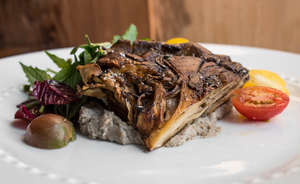 Hen of the woods mushrooms cooked under a brick