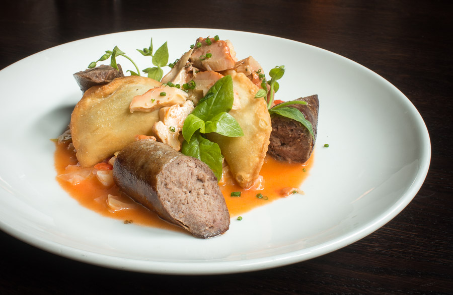 fermented ramp pierogi with chickweed, bratwurst, and chicken of the woods