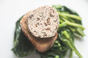 Pork tenderloin with morel mushroom butter and spinach