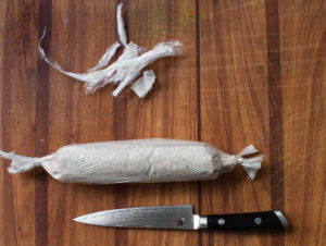 Wrapping morel mushroom butter in parchment