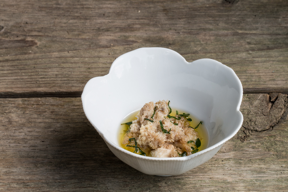 Steamed hericium corralloides mushrooms with drawn butter and fried herbs