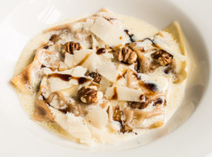 Buttercup squash ravioli with hickory nuts and birch syrup
