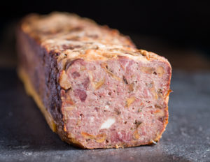 Turkey terrine with lobster mushrooms and venison bacon