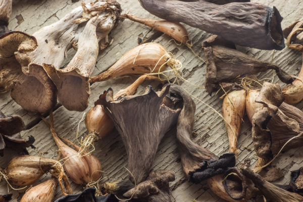 Black trumpet mushrooms (Craterellus fallax) and shallots