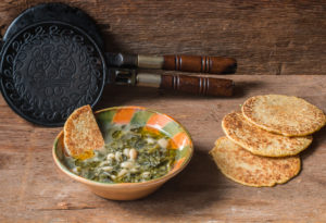 Ministrella Gallicano, an Italian soup of many wild greens and beans served with mignecci cakes