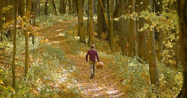 Chef Alan Bergo walking through the woods